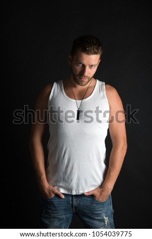 Shutterstock Man with unshaven face in studio. Fashion and beauty. Fashion model on grey background. Style and look, barber. Handsome mucho guy in vest.