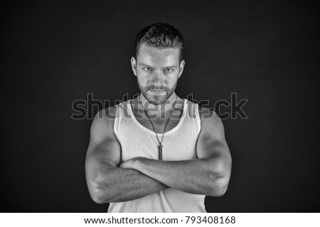 Shutterstock Man with unshaven face in studio. Fashion and beauty. Handsome mucho guy in vest. Fashion model on grey background. Style and look, barber, black and white