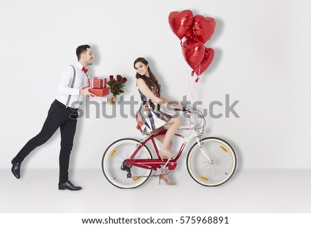 Man with Valentines presents and girl on the bike