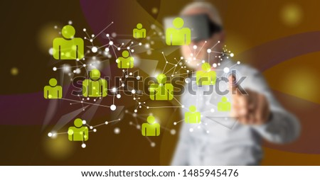Man with vr headset touching a social network on a touch screen with his finger