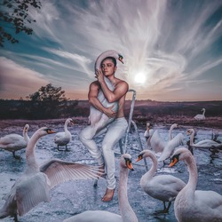 Man with white swan in nature