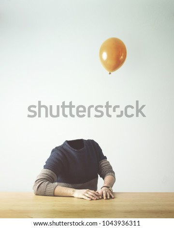 man without head obsverving balloon flying away