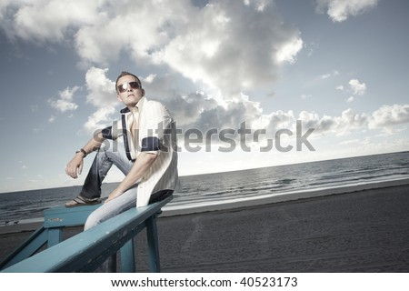 Man witting with a beautiful sunrise in the background #40523173