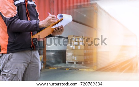 Man worker handling clipboard check list for loading shipment pallet on truck container, Logistic business concept