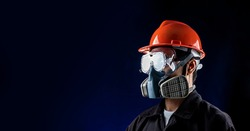 man worker wearing full protection equipments to work duty in the risk atmosphere such as hazard chemical gas or smoke or dust or pm2.5