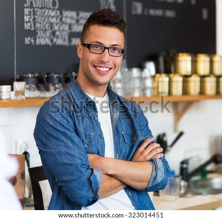 Man working in coffee shop  #323014451