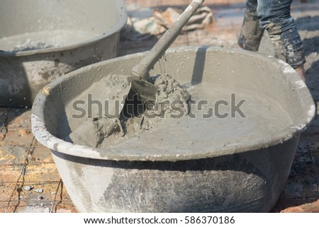 Man working mixer cements for building home