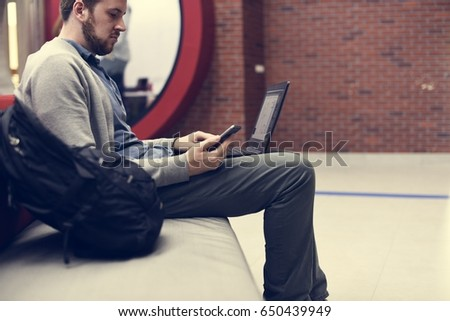 Man working on laptop networking technology #650439949