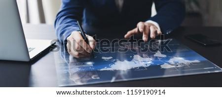 Man working on progect using high technology digital tablet #1159190914