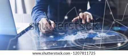 Man working on progect using high technology digital tablet #1207811725