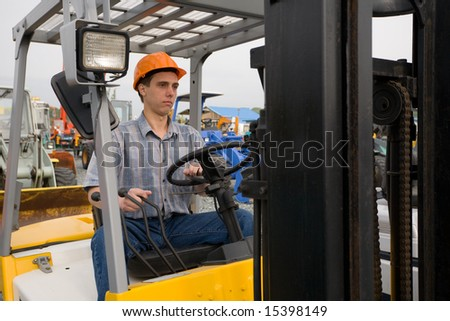 Man working on the forklift - stock photo