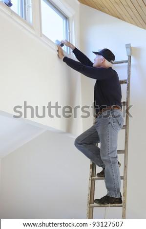Man Working on Window