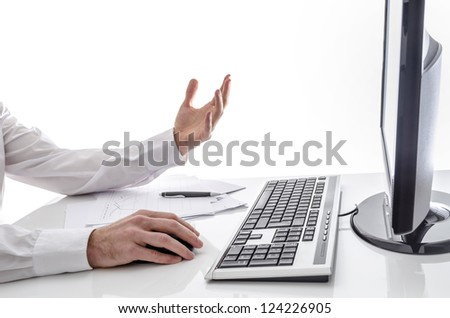 Man working online with documents in front of him.