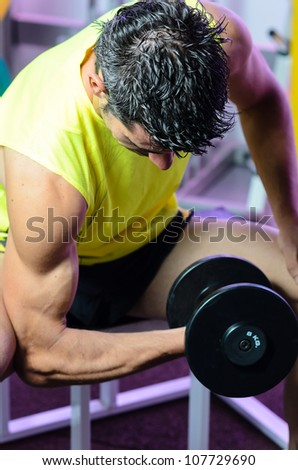 Man working out biceps dumbbell training. Man lifting weights.