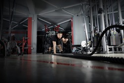 Man working out with battle ropes at gym, Functional training, Sport fitness training, Lifestyle people concept