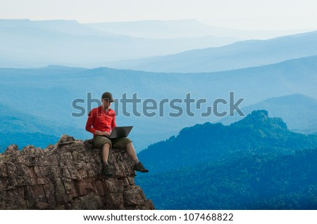 man working outdoors with laptop #107468822