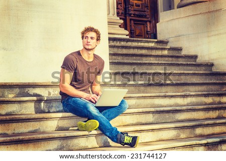 stock-photo-man-working-outside-wearing-dark-brown-t-shirt-blue-jeans-black-sneakers-a-young-sexy-guy-with-231744127.jpg