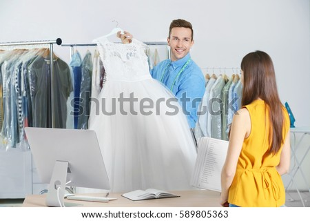 man working with customer in...