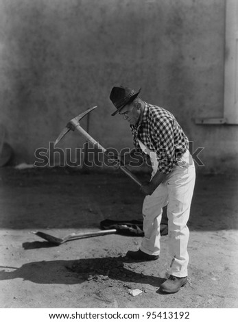 Man working with pick axe