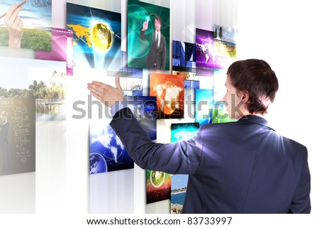Man working with vurtial screens with different images