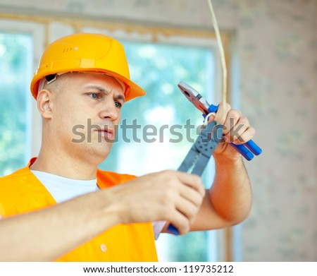 Man works with electrical wires in the new house