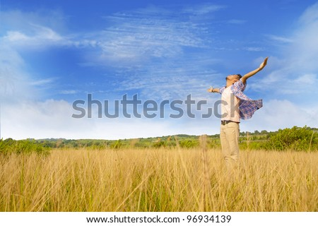 Man worshiping god shot at yellow grass