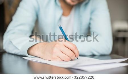 Man writing at the desk