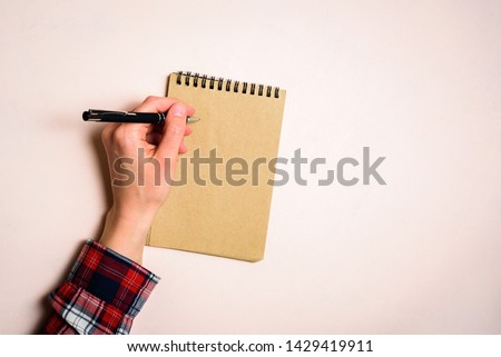 Man writing by left hand. Left hander day concept. Working place of lefty #1429419911