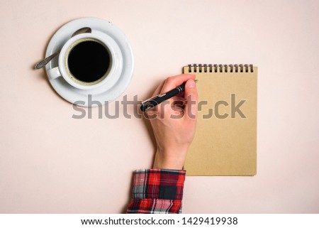 Man writing by left hand. Left hander day concept. Working place of lefty #1429419938