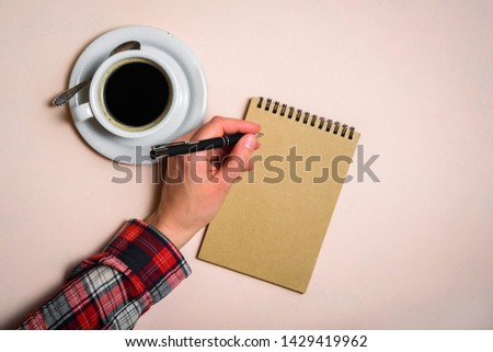 Man writing by left hand. Left hander day concept. Working place of lefty #1429419962