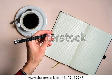 Man writing by left hand. Left hander day concept. Working place of lefty #1429419968