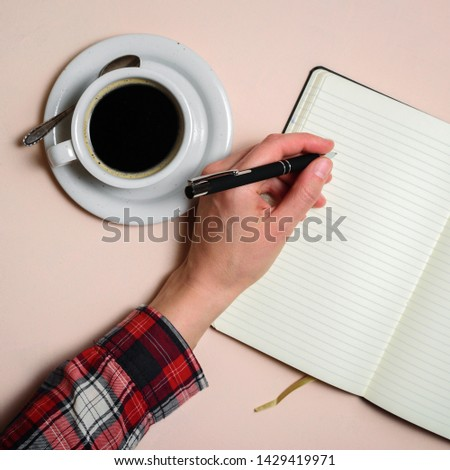 Man writing by left hand. Left hander day concept. Working place of lefty #1429419971