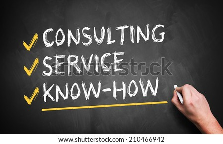 man writing consulting, service, know how on a blackboard