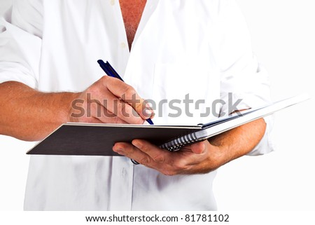 man writing in a book
