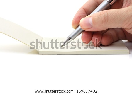 man writing in his reminder