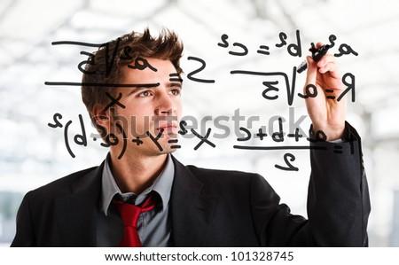 Man writing math formulas on the screen