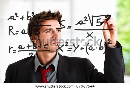 Man writing math formulas on the screen