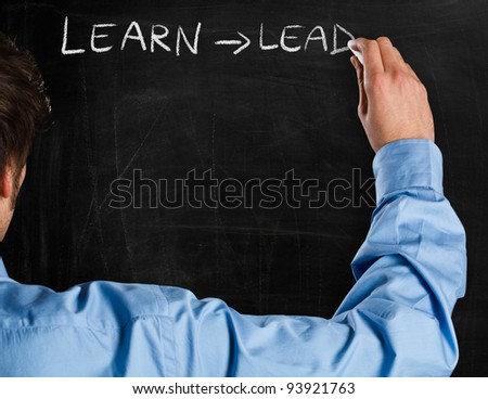 Man writing on a blackboard an educational concept