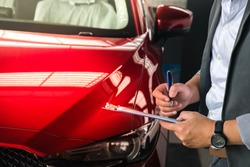 man writing on notepad or book, paper with car on wood background. Using wallpaper or background for note, transport, business, copy space image.
