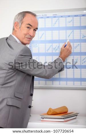 Man writing on slate