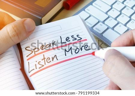 Man writing quote Speak less listen more.
