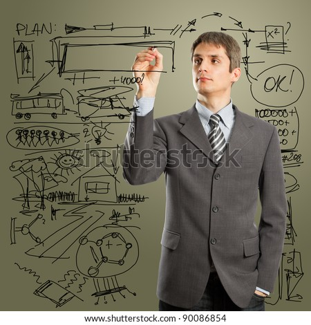 man writing something on glass board with marker