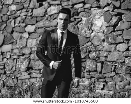 aa0ab832635 Man young handsome elegant model wears suit white shirt with black skinny  necktie looks in camera
