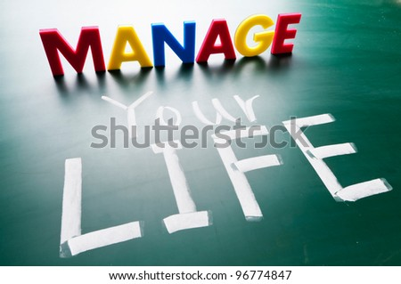 Manage your life, colorful conceptual words on blackboard. - stock photo