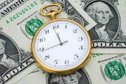 Management efficiency concept of time and money, pocket watch and US dollar banknotes