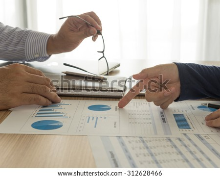 manager analyze financial numbers to view the performance of the company. accounts concept, working concept, meeting concept.