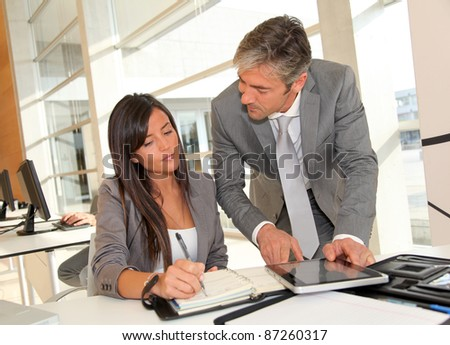 Manager and businesswoman meeting in office