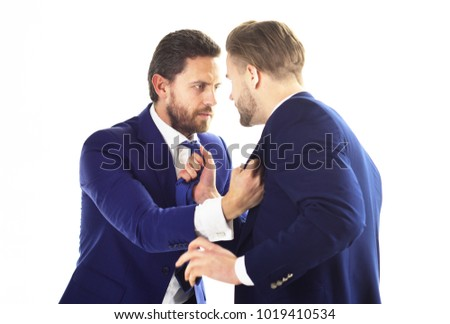 Manager and director fighting. Conflict of interest, fight, management conflict. Men wearing suits and boxing on white background. Angry coworkers. Aggression, competition, hate, revenge concept. #1019410534