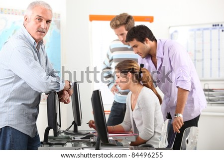 Manager and his team working at computers