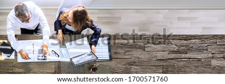 Manager And Senior Accountant Using Laptop In Office Foto d'archivio ©